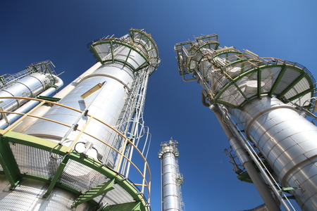Refinery tower in petrochemical plant with blue sky  Stock Photo