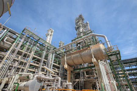 Process area of petroleum plant with blue sky