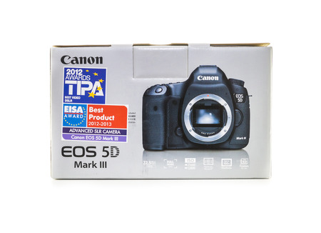 eos: RAYONG , THAILAND - DECEMBER 31 , 2014: Canon 5D Mark III DSLR in Unopened Box isolate on white background Editorial