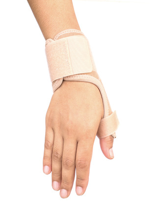 elbow brace: Close up of Thumb finger wrapped in an bandage on white background Stock Photo