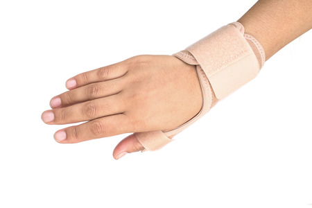 finger on trigger: Close up of Thumb finger wrapped in an bandage on white background Stock Photo
