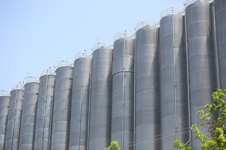 vertical chemical silos with sky