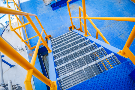 ladder steel structure blue floor and yellow handrail in industrial factory Stok Fotoğraf