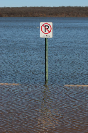 no parking sign: No Parking sign in flood waters in Missouri Stock Photo