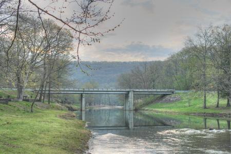 den: Bridge over water at Devils Den State Park in Arkansas