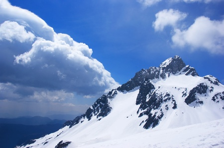 Peak of the mountain with a cloud.