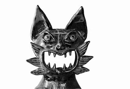 Black-and-white laughing cat of ceramics.