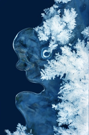 Blue icicle with snowflakes in the form of a person. Stock Photo