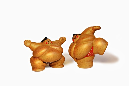 wrestlers: Two ceramic figures of sumo wrestlers.