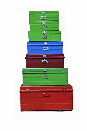 7 colored suitcases set out in the pyramid isolated Stock Photo - 12352931