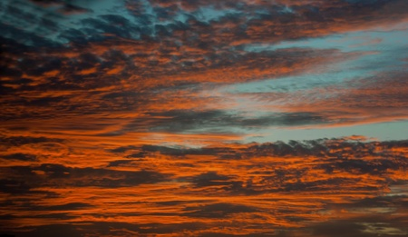 Bright orange stratus clouds at sunset