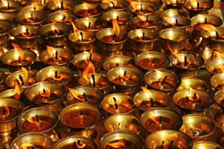 Lots of little candles in a Buddhist temple.