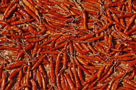 Red hot pepper lying on a straw mat. Stock Photo