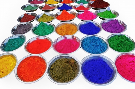 Bright colored dry paint poured in plates for sale.