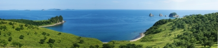 A panorama of the beautiful sea landscape with green banks. Stock Photo