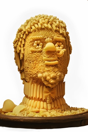 A model of a mans head is made of different kinds of dried pasta.