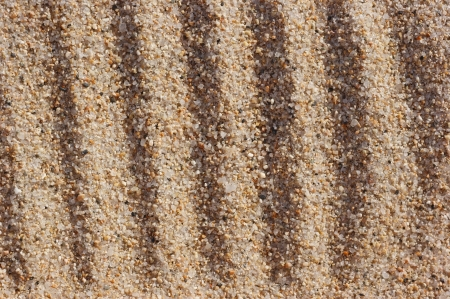 Parallel lines on the major sea sand. Stock Photo