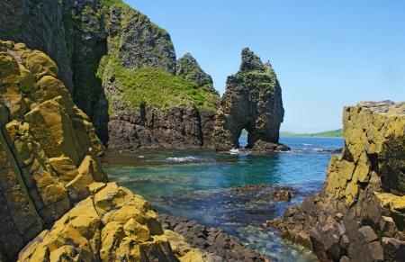 Very bright sea landscape with sharp rocks.