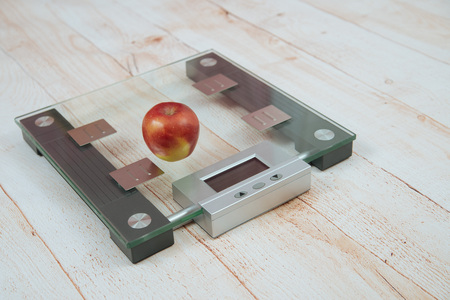 fatness: Apple and an orange are on the electronic scales