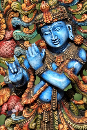 Wooden Statue of lord krishna  photo