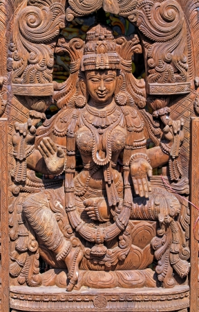 Wooden Statue of Hindu Goddess Lakshmi photo