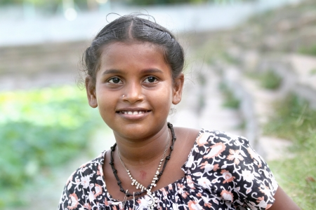Portrait of Village Girl Giving a Warm Smile photo
