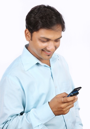 Indian Young Businessman Using a Cell Phone Stock Photo