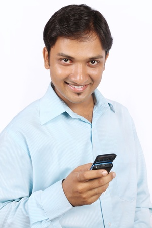 Portrait of Indian Young Businessman with Cell Phone photo
