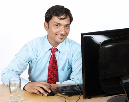 Portrait of Indian Businessman With Computer Stock Photo