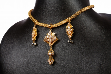 Indian Gold Necklace with gemstones photo
