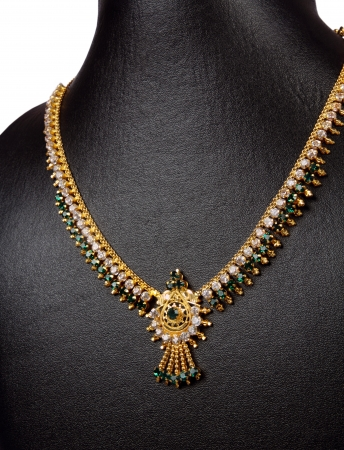 costume jewelry: Indian Gold Necklace with gemstones