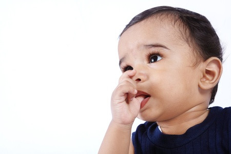 sucks:  Indian Cute Baby Sucks on His Finger Stock Photo