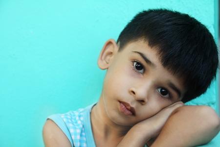 Indian Cute Boy looking depressed Stock Photo