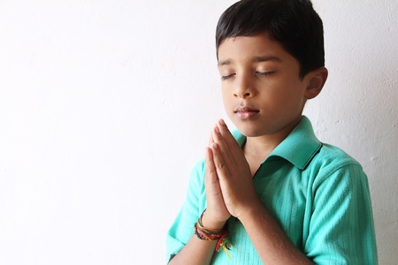 Indian Village Little Boy Praying photo