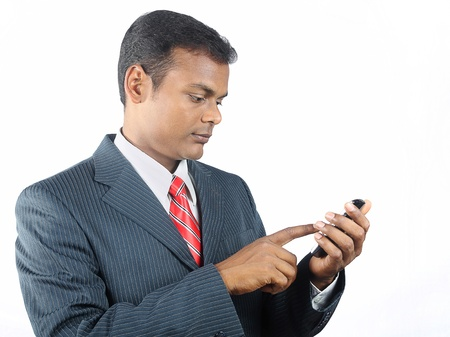 Indian business man using smartphone Stock Photo