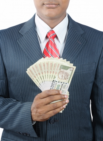 indian money: indian business man holding indian money