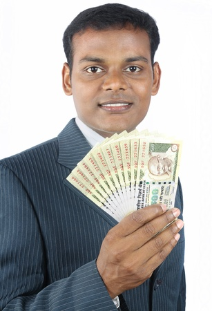 indian business man holding indian money photo