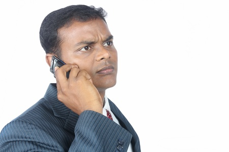 Indian businessman using a mobile phone photo