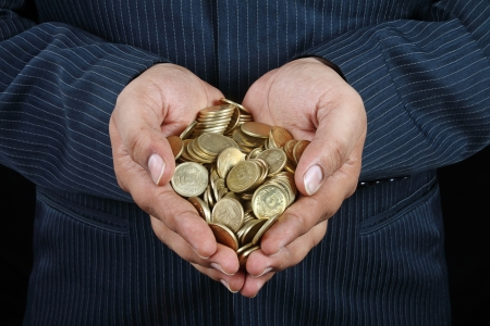 Indian Businessman Holding Gold Coins