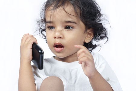 Indian baby talking on mobile phone photo