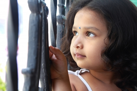 indian style sitting: Cute Indian Girl Looking up With Smile Stock Photo
