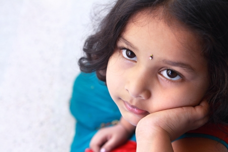 tamilnadu: Cute Indian Little Girl Looking Up Stock Photo