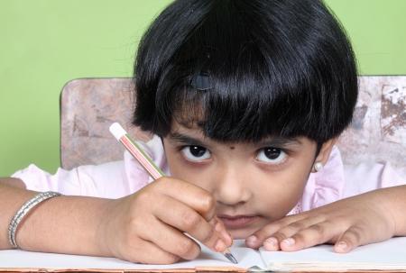 indian school girl: Indian School Girl Doing Homework