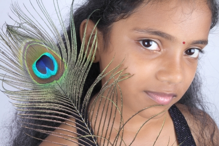 beautiful Teenage Girl with peacock feather photo