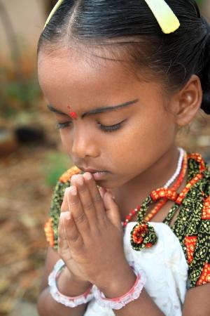 Indian Cute Girl Praying 免版税图像