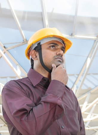 executive helmet: Thinking young Indian Architect Stock Photo