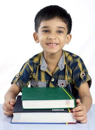 indian boy: Indian Little Boy with Textbooks Stock Photo