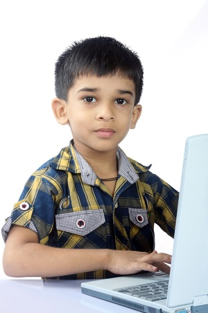 Indian School Boy using a laptop Stock Photo