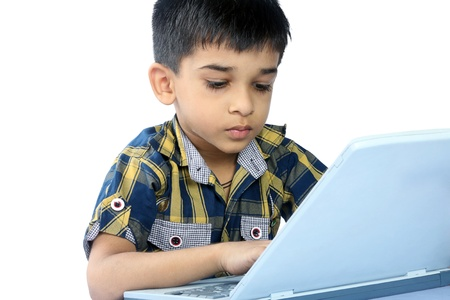 Portrait of Indian Boy using a laptop photo