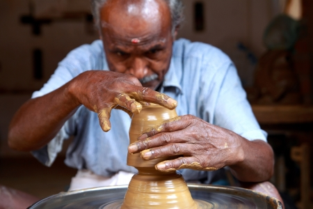 Indian Potter making new Pot photo